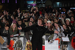 © licensed to London News Pictures. London, UK 10/01/2013. Quentin Tarantino posing with his fans at the UK premiere of Django Unchained in Leicester Square, London. Photo credit: Tolga Akmen/LNP