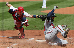 August 13, 2017 - St Louis, MO, USA - St. Louis Cardinals catcher Carson Kelly is unable to tag Atlanta Braves' Nick Markakis as Markakis scores on a sacrifice fly by Ozzie Albies in the fourth inning during a game between the St. Louis Cardinals and the Atlanta Braves on Sunday, August 13, 2017, at Busch Stadium in St. Louis. (Credit Image: © Chris Lee/TNS via ZUMA Wire)