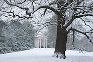 A snow covered temple in Kew Gardens, Kew, London, UK