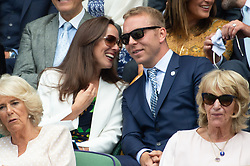 © Licensed to London News Pictures. 11/07/2018. London, UK. Lady Hoy and Sir Chris Hoy watches centre court tennis in the royal box at the Wimbledon Tennis Championships 2018, at the All England Lawn Tennis and Croquet Club. Photo credit: Ray Tang/LNP
