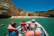Algarve, Portugal, June 2014. A boat trip to the Gruta de Benagil caves near Carvoeiro offers a view on 20 different caves.  A spectacular coastline of steep sandstone cliffs borders hidden sandy beaches on the south western tip of Europe, where the Mediterranean becomes the Atlantic Ocean.  Photo by Frits Meyst / MeystPhoto.com