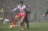 Stevenage midfielder Charlie Carter(7) and Swansea City midfielder Yan Dhanda(21) battles for possession during the FA Cup match between Stevenage and Swansea City at the Lamex Stadium, Stevenage, England on 9 January 2021.
