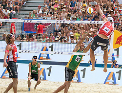31.07.2016, Strandbad, Klagenfurt, AUT, FIVB World Tour, Beachvolleyball Major Series, Klagenfurt, Herren, im Bild Aleksandrs Samoilovs (1, LAT), Janis Smedins (2, LAT) vorne, Gustavo Carvalhaes (1, BRA), Saymon Barbosa Santos (2, BRA) hinten // during the FIVB World Tour Major Series Tournament at the Strandbad in Klagenfurt, Austria on 2016/07/31. EXPA Pictures © 2016, PhotoCredit: EXPA/ Lisa Steinthaler