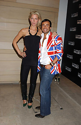 JULIEN MACDONALD and actress MARGO STILLEY at a cocktail party hosted by MAC cosmetics to kick off London Fashion Week at The Hospital, 22 Endell Street London on 18th September 2005.At the event, top model Linda Evangelista presented Ken Livingston the Lord Mayor of London with a cheque for £100,000 in aid of the Loomba Trust that aims to privide education to orphaned children through a natural disaster or through HIV/AIDS.<br />