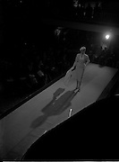 19/11/1956<br /> 11/19/1956<br /> 19 November 1956<br /> Irene Gilbert fashion show at the Shelbourne Hotel, Dublin. Picture shows model on the catwalk at the event.