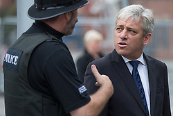 © Licensed to London News Pictures . 20/09/2014 . Manchester , UK . The Speaker of the House of Commons JOHN BERCOW talking to a policeman outside the cathedral . Departures at the funeral of Heywood and Middleton MP Jim Dobbin at Salford Cathedral today (Saturday 20th September 2014) . Photo credit : Joel Goodman/LNP