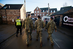© Licensed to London News Pictures. 29/12/2015. York, UK. Royal Electrical and Mechanical Engineer soldiers in the Huntington Road area of York on December 29, 2015. Further rainfall is expected over coming days as Storm Frank approaches the east coast of the country. Photo credit: Ben Cawthra/LNP