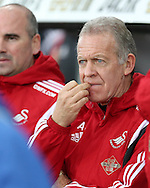 Swansea city caretaker manager Alan Curtis bites his finger nails as he looks on from the dugout.  Barclays Premier league match, Swansea city v West Bromwich Albion at the Liberty Stadium in Swansea, South Wales  on Boxing Day Saturday 26th December 2015.<br /> pic by  Andrew Orchard, Andrew Orchard sports photography.