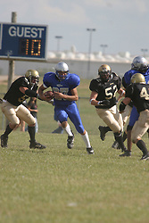 14 August 2004  Storms Derek Overton looks for space on a  run back  after intercepting the ball.    Twin City Storm V Capitol City Outlaws, Midwest Football League, Interstate Center, Bloomington-Normal IL