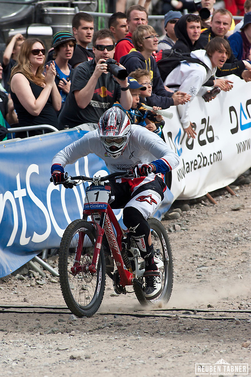 Greg Minnaar (South Africa) of team Santa Cruz Syndicate crosses the line during the final of the mens downhill, he came second by 0.48 seconds to Gee Atherton at the UCI Mountain Bike World Cup in Fort William, Scotland.