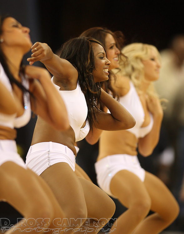 The Warriors Girls cheerleaders entertain the crowd at the Golden State Warriors-Houston Rockets NBA basketball game, Wednesday, Oct. 28, 2009 at Oracle Arena in Oakland, Calif. The Warriors lost their season opener, 108-107. (D. Ross Cameron/Staff)