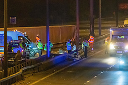 © Licensed to London News Pictures. 01/04/2020. Gerrards Cross, UK. An overturned HGV on the northbound carriageway of the M40 motorway between junction 1 and junction 2 along side damaged median barriers. The M40 motorway was closed in both directions due to a Road Traffic collision involving a heavy goods vehicle and at least to cars. Photo credit: Peter Manning/LNP