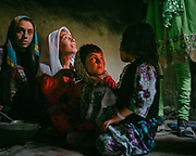 Children waiting for food. The festivities around the muslim celebration of Eid-e Qurban (the holiday of Sacrifice) in the village of Qala-e Panja. The traditional life of the Wakhi people, in the Wakhan corridor, amongst the Pamir mountains.