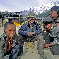 CHINA, TIBET, Tsangpo River Gorge. Village children in Gyala.  Mt. Namcha Barwa bkg.