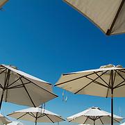 Umbrellas and sky..Isla Mujeres, Quintana Roo..Mexico.