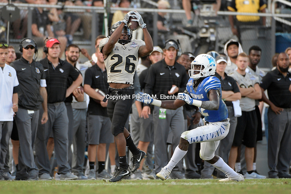 Central Florida wide receiver Otis Anderson (26) catches a pass in front of Memphis defensive back Tyrez Lindsey (22) during the second half of the American Athletic Conference championship NCAA college football game Saturday, Dec. 2, 2017, in Orlando, Fla. Central Florida won 62-55. (Photo by Phelan M. Ebenhack)