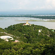 View from Soon Oo Pon Nya Shin Pagoda, Sagaing. Sitting on top of Nga-pha Hill, Soon Oo Pon Nya Shin Pagoda is one of multiple pagodas and temples in the religious district of Sagaing, near Mandalay. The original pagoda dates to 674.