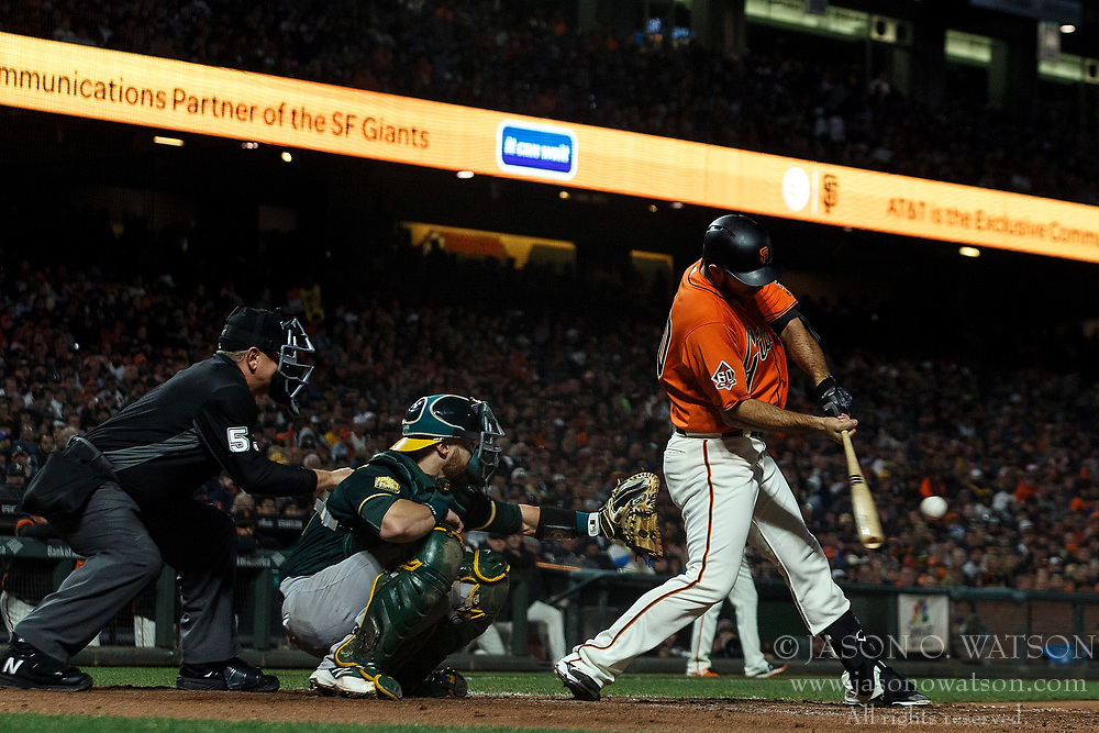 SAN FRANCISCO, CA - JULY 13: Madison Bumgarner #40 of the San Francisco Giants at bat against the Oakland Athletics during the fifth inning at AT&T Park on July 13, 2018 in San Francisco, California. The San Francisco Giants defeated the Oakland Athletics 7-1. (Photo by Jason O. Watson/Getty Images) *** Local Caption *** Madison Bumgarner
