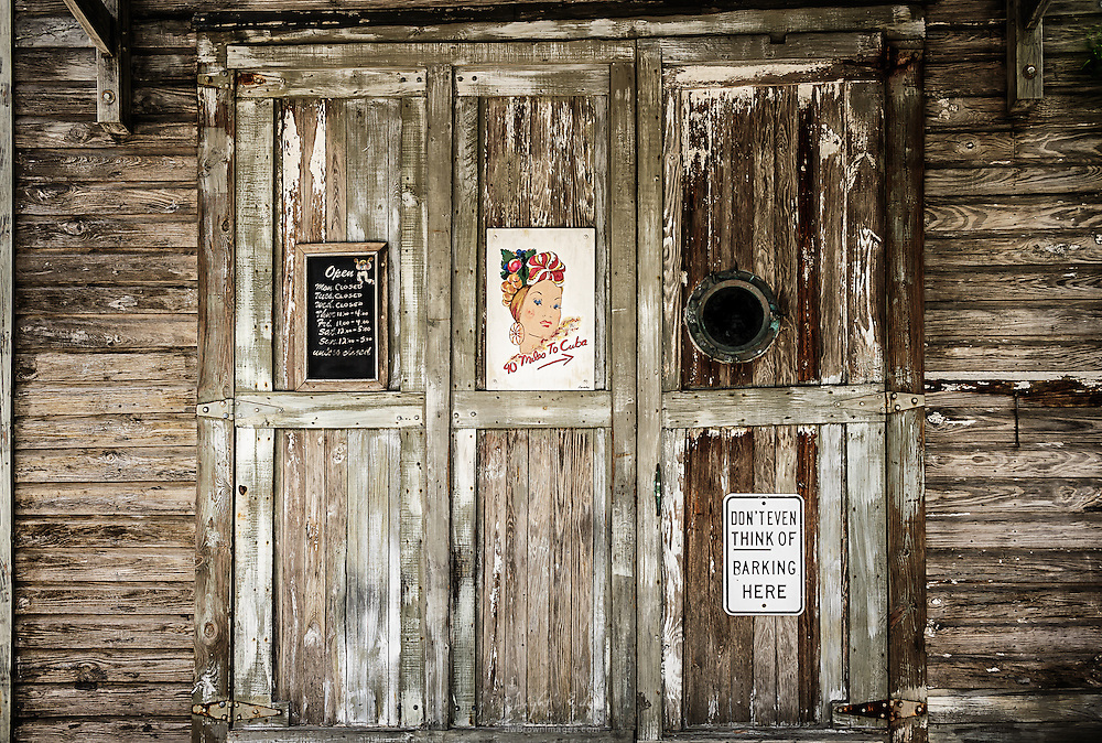 An entrance to a business in Key West, Fl that is open unless closed.