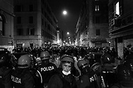 """A moment during the clash between the police and the protesters at the demostration in Roma organized by left movements after the eviction of the """"Nuovo Cinema Palazzo""""  community center in San Lorenzo neighborhood on 25 November, Italy."""