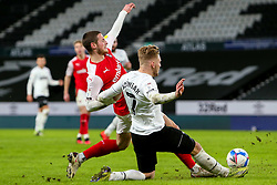 Kamil Jozwiak of Derby County slides in to tackle Ben Wiles of Rotherham United - Mandatory by-line: Ryan Crockett/JMP - 16/01/2021 - FOOTBALL - Pride Park Stadium - Derby, England - Derby County v Rotherham United - Sky Bet Championship