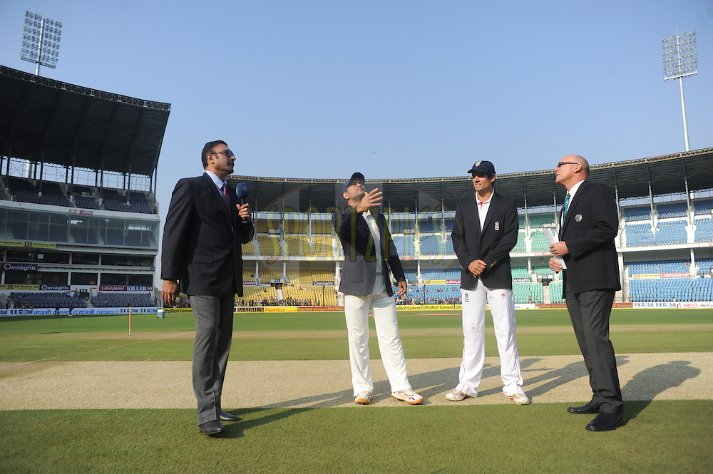 MS Dhoni captain of India(2R) and Alastair Cook captain of England (2L) during the toss before the start of the match on day one of the 4th Airtel Test Match between India and England held at VCA ground in Nagpur on the 13th December 2012..Photo by  Pal Pillai/BCCI/SPORTZPICS .