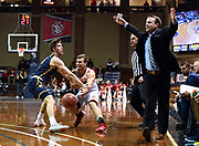 Sam Masten of Northern Colorado knocks the ball from USD player Cody Kelley's hand as Northern Colorado coach Jeff Linder reacts to a foul being called on Friday, Dec. 20, 2019, at the Pentagon in Sioux Falls, SD.