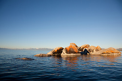 """""""Boulders on Lake Tahoe 17"""" - These orange, black, and grey boulders were photographed in the early morning near Speedboat Beach, Lake Tahoe."""