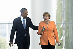 59860288    <br /> Barack Obama, president of the USA, and German Chancellor Angela Merkel (right) during a press call at a state visit of the Chancellery in Berlin, Germany. Barack Obama will walk in John F. Kennedy's footsteps this week on his first visit to Berlin as US president, but encounter a more powerful and sceptical Germany in talks on trade and secret surveillance practices. International Politics, Berlin, Germany on Wednesday 19 June, 2013. UK ONLY