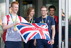 © Licensed to London News Pictures . 18/08/2016 . Manchester , UK . L-R Olympic cyclists ED CLANCY MBE , JOANNA ROWSELL MBE , JASON KENNY OBE and STEVEN BURKE MBE arrive at Manchester Airport after medal success at the Rio Olympics . Photo credit : Joel Goodman/LNP