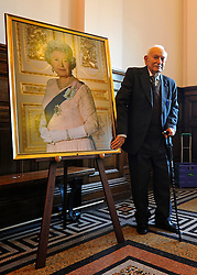 """© Licensed to London News Pictures. 02/02/2012, Kingston Upon Thames, UK. 104 year-old becomes Britain's oldest new citizen. Mr Khanjar with a portrait of Queen Elizabeth II. 104 year-old TAUFEEK KHANJAR became a British Citizen at a ceremony held by Surrey County Council today (01 February 2012). Mr Khanjar is originally from Iraq and worked as a jewellery maker in Baghdad. He came to the UK six years ago to live with his daughter Nada Dabis, 59, in South Cheam, Surrey, where he enjoys walking, feeding the birds, playing cards and listening to music. He is a widower with four sons and two daughters. Durning the ceremony Mr Khanjar took an oath to the Queen, pledging that he will be a faithful citizen and obey the laws of the country. He explained the secret to a long and healthy life was to """"never get stressed and be relaxed"""".  Photo credit : Stephen Simpson/LNP"""