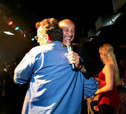23 Feb 2006. New Orleans, Louisiana. <br /> Ray Nagin, mayor of New Orleans and writer Chris Rose at the the Krewe of Muses pre float boarding party at The Venue club. Muses is the only all women's Krewe to parade in New Orleans and is known for its satire, famous shoe throws and is generally considered one of the most popular parades of the Mardi Gras.<br /> Photo © Charlie Varley/varleypix.com