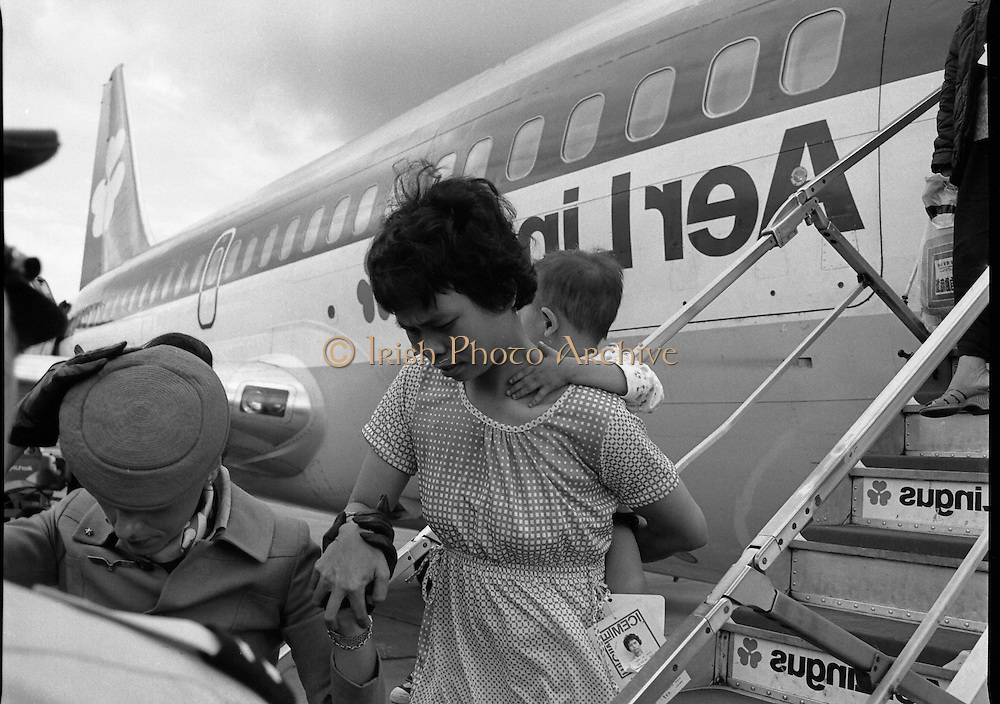 Vietnam Refugees Arrive .09/08/1979.08/09/1979.9th August 1979.Photograph shows a refugee and her young child coming off the plane.