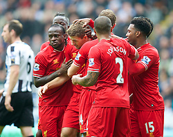 19.10.2013, St. James Park, New Castle, ENG, Premier League, ENG, Premier League, Newcastle United vs FC Liverpool, 8. Runde, im Bild Liverpool's captain Steven Gerrard is mobbed by team-mates after scoring the first equalising goal against Newcastle United // during the English Premier League 8th round match between Newcastle United and Liverpool FC St. James Park in New Castle, Great Britain on 2013/10/19. EXPA Pictures © 2013, PhotoCredit: EXPA/ Propagandaphoto/ David Rawcliffe<br /> <br /> *****ATTENTION - OUT of ENG, GBR*****