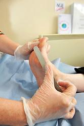 Chiropodist at an NHS foot clinic, Bradford