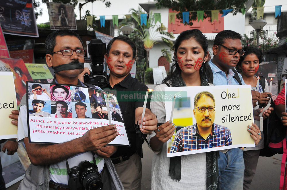 June 15, 2018 - Kolkata, West Bengal, India - Indian Journalist and Photojournalist silent candle light pray and protest the Journalist killing issue ,Recently slain editor-in-chief of the Srinagar-based newspaper Rising Kashmir Shujaat Bukhari was leaving his office in Srinagar on Thursday evening when three assailants roared up and fired several shots from close range. (Credit Image: © Debajyoti Chakraborty/NurPhoto via ZUMA Press)