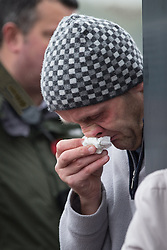© Licensed to London News Pictures . 11/11/2012 . Lytham Park Crematorium , UK . A man cries as the service is relayed outside via loudspeaker . Hundreds of strangers at the funeral of World War Two veteran Harold Jellicoe Percival today (Monday 11th November 2013) . The funeral is timed to coincide with the First World War armistice , the 95th anniversary of which is at 11am today (Monday 11th November 2013) . The RAF Bomber Command veteran died in his sleep on 25th October 2013 , aged 99 , at Alistre Lodge Nursing Home in St Annes , Lancashire , with no immediate family . Photo credit : Joel Goodman/LNP