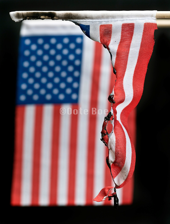 burned American flag against a black background