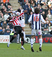 Photo: Mark Stephenson.<br />West Bromwich Albion v Sunderland. Coca Cola Championship. 03/03/2007. Sunderland's Stern John trys to win the header with Curtis Davis