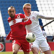 Turkey U21's Sercan Yildirim (L) and Denmark U21's Frederik Sorensen (R) during their friendly soccer match Turkey U21 betwen Denmark U21 at Recep Tayyip Erdogan stadium in Istanbul February 29, 2012. Photo by TURKPIX