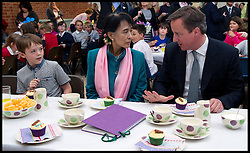 Myanmar pro-democracy leader Aung San Suu Kyi and British Prime Minister David Cameron stop for a cup of tea during a visit to Aston Pottery on June 22, 2012 in Aston, England. Burmese opposition leader Aung San Suu Kyi is on a four-day visit to the UK during her first trip to Europe since 1988, Oxfordshire, Friday June 22, 2012. Photo by Andrew Parsons/i-Images..All Rights Reserved ©Andrew Parsons/i-Images .See Special Instructions