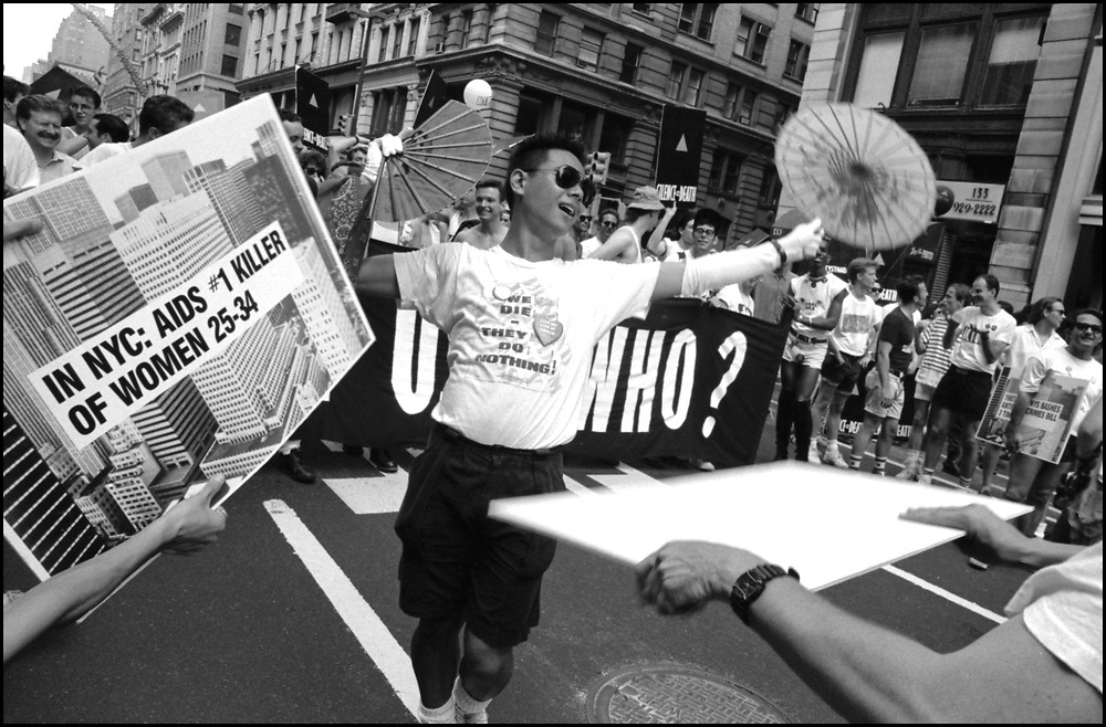 """Jose Fidelino of ACT UP NY, on June 24, 1989, the 20th anniversary of the Stonewall riots, participating in a renegade march up 6th avenue to Central Park. Themed, """"In The Tradition"""", this march followed the same route as the original march 20 years ago and was designed as a rebuke to the corporatization of the gay pride parade."""
