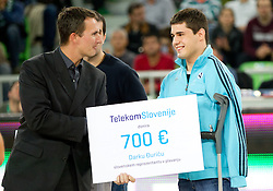 Donation of Telekom Slovenia for paralympic sportsmen Viki Vinkler and  Dako Duric during basketball match between KK Union Olimpija and Galatasaray Medical Park (TUR) of 4th Round in Group D of Regular season of Euroleague 2011/2012 on November 9, 2011, in Arena Stozice, Ljubljana, Slovenia. Galatasaray defeated Union Olimpija 79-70. (Photo by Vid Ponikvar / Sportida)