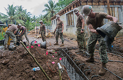 WALUNG, Micronesia (May 19, 2017) Sailors assigned to Naval Mobile Construction Battalion (NMCB) 1 place concrete during the construction of the Walung Health Clinic in Walung, Kosrae.  NMCB 1 provides expeditionary construction and engineering support to expeditionary bases and responds to humanitarian assistance disaster relief requests. (U.S. Navy photo by Information Systems Technician 1st Class Ledget Glover III/Released)170519-N-YV613-0768<br /> Join the conversation:<br /> http://www.navy.mil/viewGallery.asp<br /> http://www.facebook.com/USNavy<br /> http://www.twitter.com/USNavy<br /> http://navylive.dodlive.mil<br /> http://pinterest.com<br /> https://plus.google.com