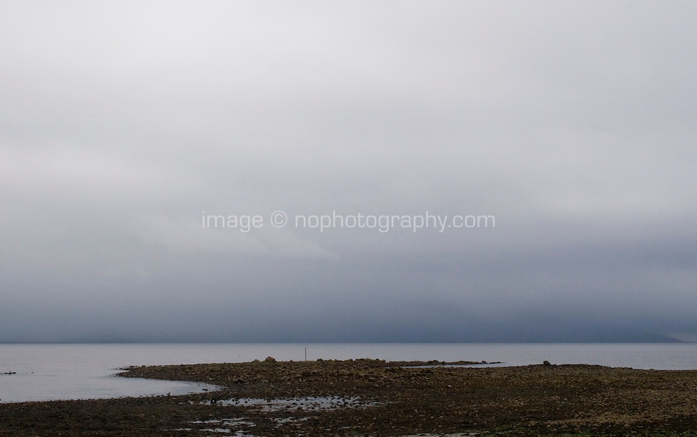 Rainy overcast weather and seaweed at low tide in Spiddle County Galwar Ireland