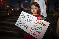 AJ Bautistam , 5, from Naples at a protest in New Orleans at Lee Circle against police brutality following the killing of Alton Sterling in Baton Rouge and Philando Castile in Minnesota on July 8, the day after 5 police officers will killed by a sniper in Dallas.