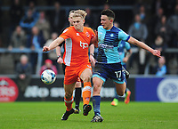 Blackpool's Brad Potts under pressure from Wycombe Wanderers' Luke O'Nien<br /> <br /> Photographer Kevin Barnes/CameraSport<br /> <br /> The EFL Sky Bet League Two - Wycombe Wanderers v Blackpool - Saturday 11th March 2017 - Adams Park - Wycombe<br /> <br /> World Copyright © 2017 CameraSport. All rights reserved. 43 Linden Ave. Countesthorpe. Leicester. England. LE8 5PG - Tel: +44 (0) 116 277 4147 - admin@camerasport.com - www.camerasport.com