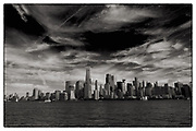 Art surrounds us, as evidenced by these dramatic, sweeping clouds over the World Trade Center and the activity in New York Harbor.