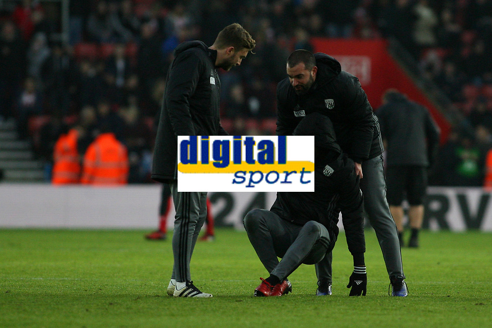 Football - 2016 / 2017 Premier League - Southampton vs. West Bromwich Albion<br /> <br /> Substitute Jonathan Leko of West Bromwich Albion injures himself during the half time kick about at St Mary's Stadium Southampton England<br /> <br /> COLORSPORT/SHAUN BOGGUST