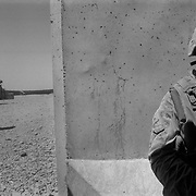 Sep 05, 2009 - Delaram, Nimroz Province, Afghanistan - A US Marine from the 2nd MEB of the 2/3 Marines stands in a bunker following a suicide attack on a civilian convoy on Highway 1 outside the US Marine Forward Operating base Delaram, a strategic and economic crossroads in South Eastern Afghanistan located in Nimroz Province. The suicide attack was made using a Vehicle Borne Improvised Explosive Device (VBIED) killing three Afghans and injuring several others. (Credit Image: © Louie Palu/ZUMA Press)